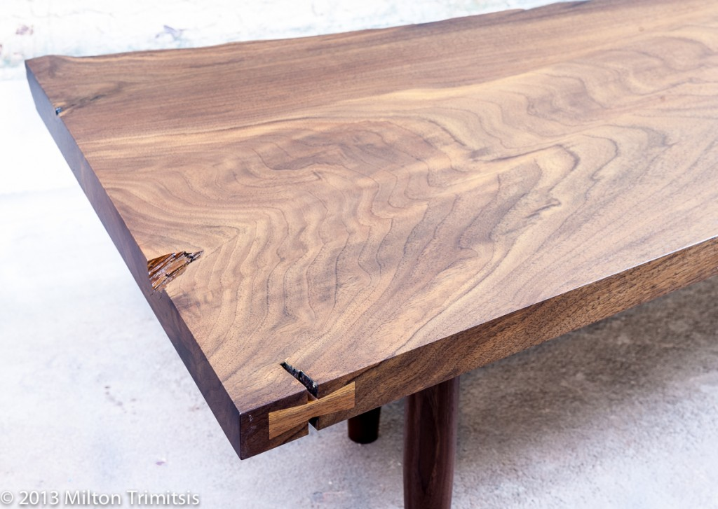 Detail of walnut coffee table in the style of George Nakashima