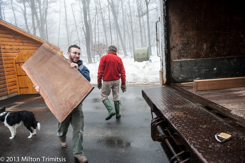 Loading wide walnut board into box truck