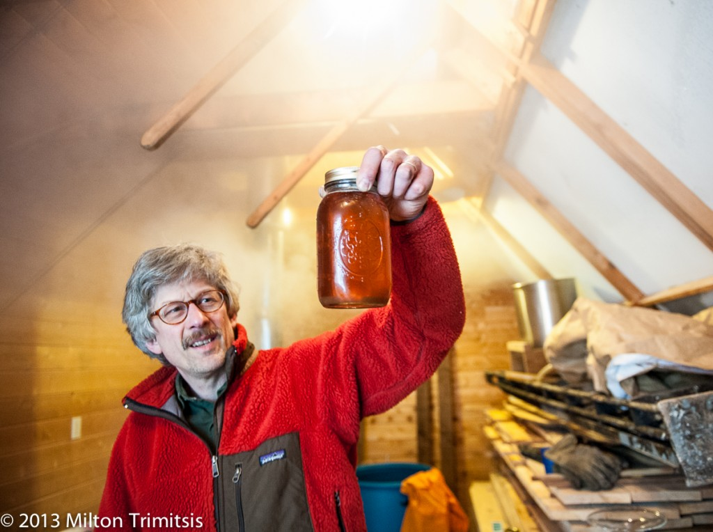 Paul Koval holding jar of maple syrup