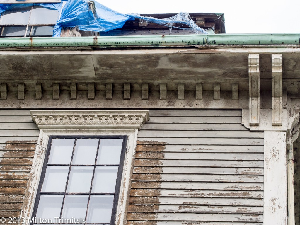 Detail of brackets on old Victorian house in need of repair