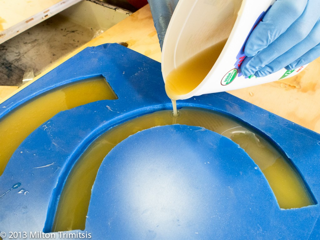 Pouring urethane resin into a silicone mold, closeup