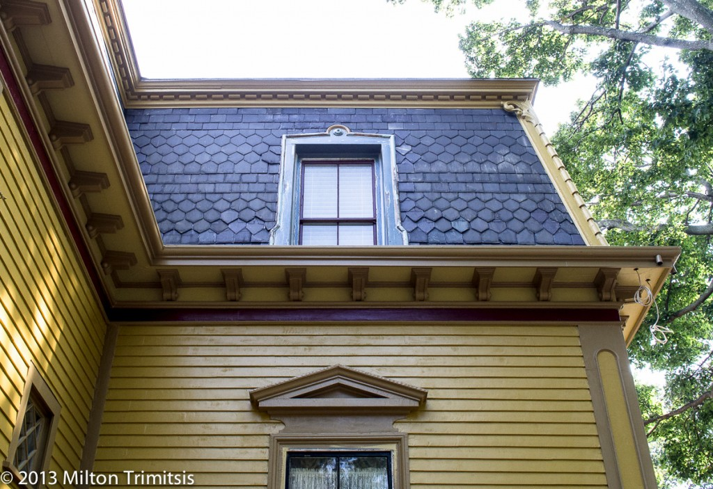 mansard window with plastic part completing band molding