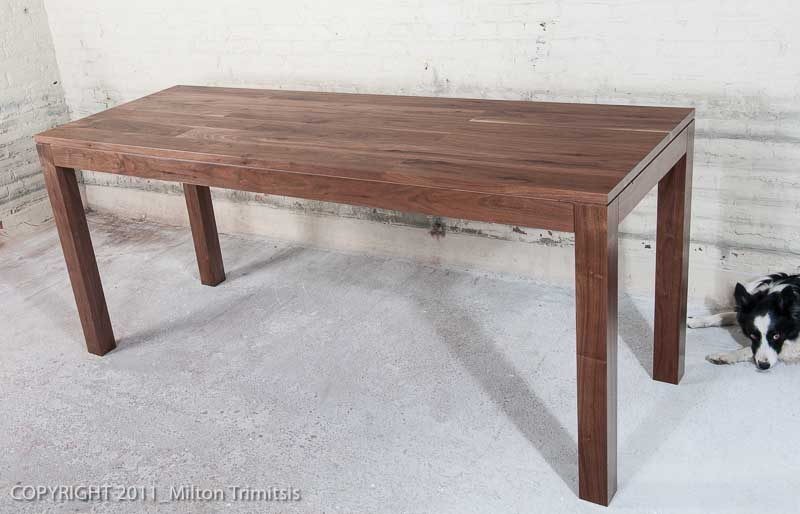 Modernist walnut table with border collie