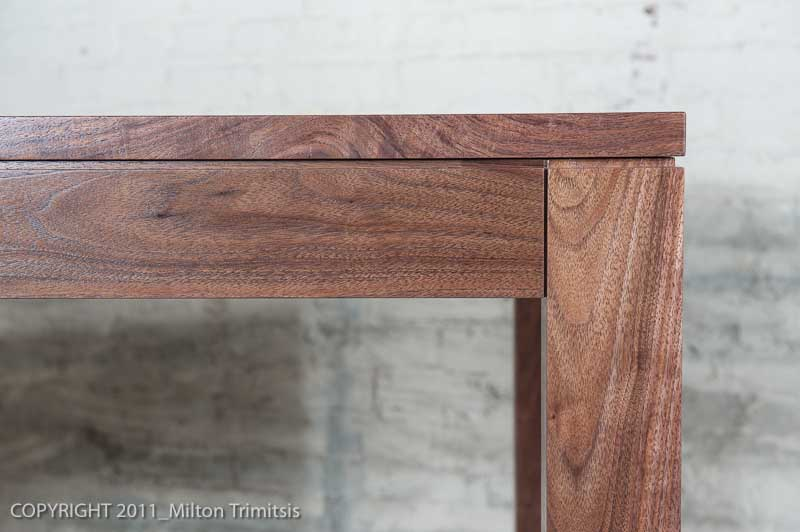 Detailed view of modernist walnut kitchen table
