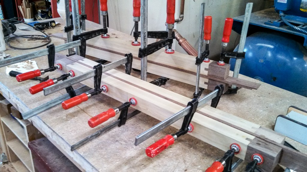 walnut and poplar table legs in clamps