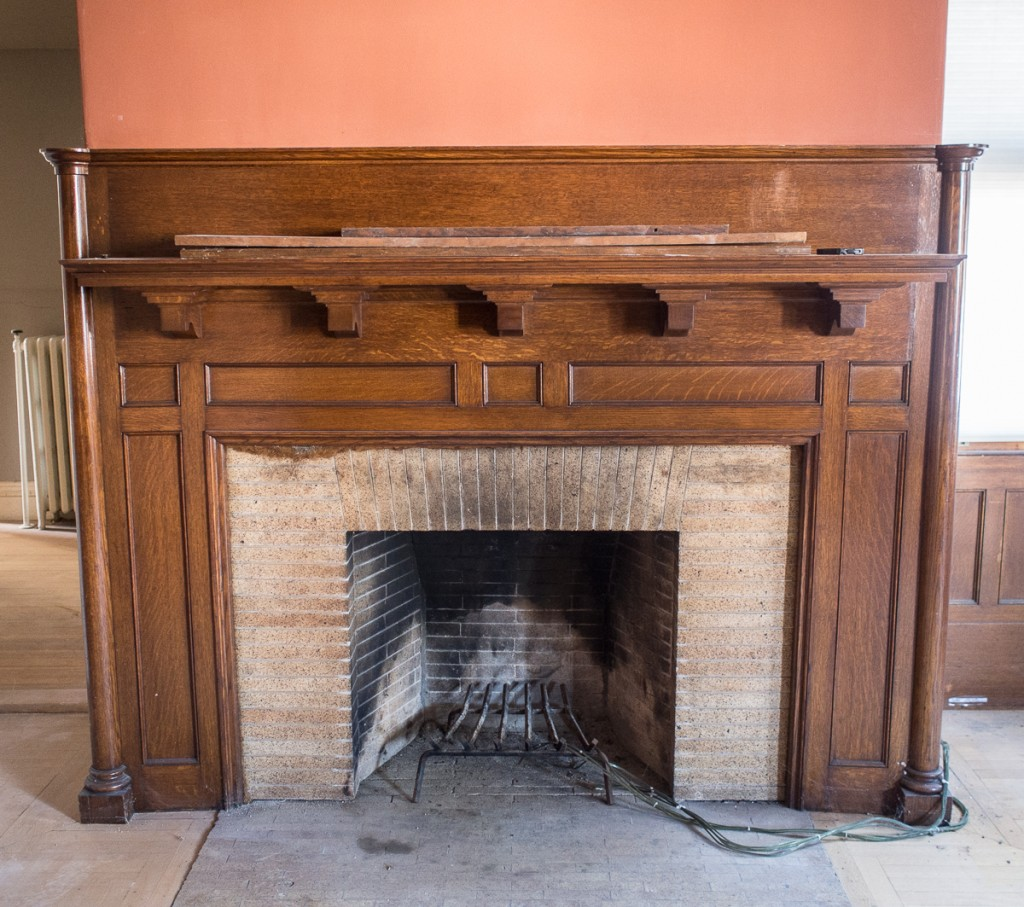 Oak mantel and fireplace from late 19th century