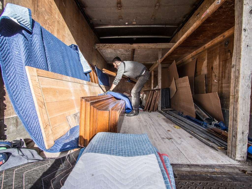 Loading salvaged library cabinets into box truck