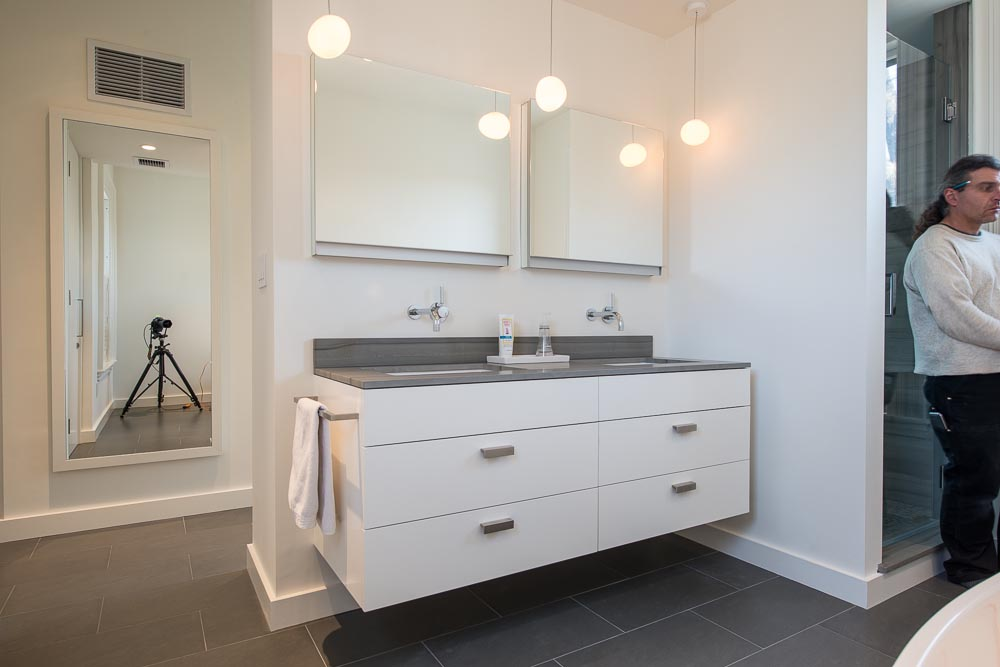 Custom vanity cabinet with camera and photographer visible in background